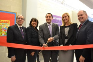 At the center's ribbon-cutting ceremony were (from left to right): Supportive Children's Advocacy Network (SCAN)'s Executive Director Lewis Zuchman, Department of Youth and Community Development Commissioner Jeanne B. Mullgrav; New York State Assemblymember Robert Rodriguez; former Commissioner Commissioner of NYC's Department of Information Technology and Telecommunications (DoITT) Carole Post; and John Quigley, Regional Vice President of Operations for Time Warner in New York.