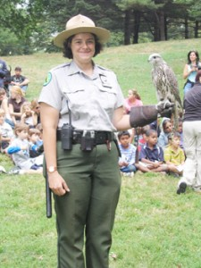 Sergeant Sunny Corrao, a New York City Urban Park Ranger stationed in the Inwood Hill Park Nature Center, here holds a gyrfalcon.