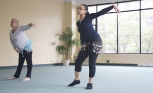 Dancers during Turull's class are actively involved in every step, and twist.