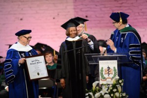Civil rights activist Dr. Hazel N. Dukes, president of the NAACP New York State Conference (center), receives Touro College of Osteopathic Medicine's first honorary Doctor of Human Letters during the College's graduation ceremony at the Apollo.