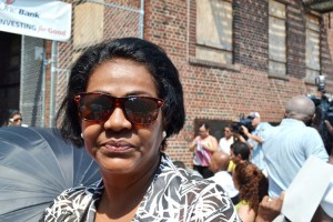 """Ramona De Los Santos, a building resident of over 30 years prior to displacement, said, """"I am ready to come back home already; I practically have skates on."""""""