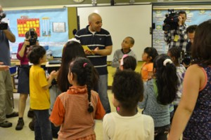 Mohamed Mamdouh (standing, center) teaches Arabic three times a day at P.S. 368.