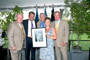 Coogan's Restaurant co-owners Peter Walsh, Dave Hunt and Tess O'Connor receive the Small Business of the Year Award from NYC Department of Small Business Services Commissioner Rob Walsh.