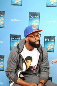 New York Knick Point guard Baron Davis signs autographs and speaks with a young man during the NBA player's visit uptown to the Dyckman Games tournament.