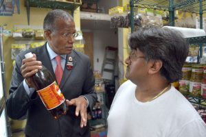 Councilmember Robert Jackson spoke with local small business owners about the proposed ban.