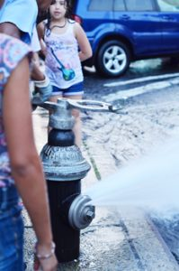 The New York City Department of Environmental Protection seeks to remind local residents of the dangers of open fire hydrants.  Photo credit: Isaacc Garcia