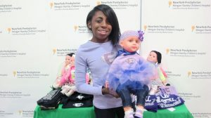 "La Trece Joi Russell is the creator of the Joi Doll, created to empower children suffering from illness, ""[like a] frilly superhero."""