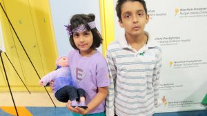 "Fajr Hafiz (left) and her brother Owaiz. Said Fajr of Columbia Presbyterian's Morgan Stanley Children's Hospital, where she spends a great deal of time: ""It's a nice place to hang out."""