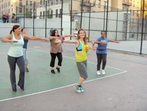 """Roxanne Carrano (center) leads a Zumba fitness class at J. Hood Wright Park. """"Zumba is more fun, more intense,"""" explained Carrano."""