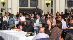 Parents listen to elected officials at a luncheon at the Great Hall.