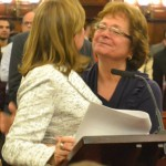 The Speaker is congratulated by her mother.