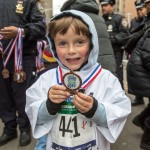 Each child was awarded with a medal upon crossing the finish line. Photo: NYRR