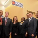 Pictured left to right (front row): John Hope Bryant, Founder, Chairman and CEO, Operation HOPE, Inc.; Brian Doran, NY Metro Region Executive, Popular Community Bank (PCB); Mary Hagerty Ehrsam, CEO, New York and Division President, HOPE Youth Empowerment Group Operation HOPE, Inc.; PCB Assistant Branch Manager Charlene Wint; Manuel Chinea, COO of PCB; Stephanie Penceal, Small Business Program Manager, HOPE Inside. Pictured from left to right (back row): Rafael Sánchez, PCB Regional Manager, Manhattan North, Bronx and Queens; and Malik Hodges, PCB 125th Street Branch Manager. Photo: QPHOTONYC
