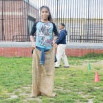 Janelsy Tulier practices for the potato sack race.