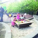 The George Washington Bridge Park features a sandbox, activity table and play equipment.