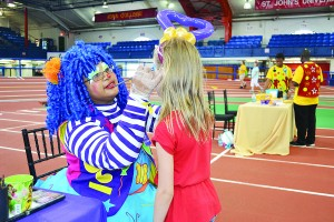 Jana Petrovic has her face painted by JJ the Clown.