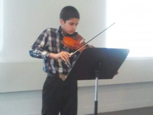 Ivan, 13, has studied the violin and then the piano for the past two years.
