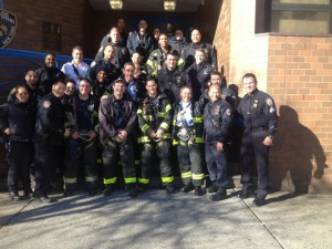 Police officers at the 34th Precinct were visited by local firefighters on Christmas Day.