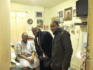 Meal recipient (seated) is visited by sous chef Joseph Smalls (middle) and Chef JJ Johnson.