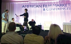 On stage from left, Jeruvia with entertainment excutives Tobin Armbrust and Cassian Elwes (seated) and Stephanie Palmer, author of <i>Good in a Room</i>.