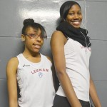 Kashana Smith-Kellam (left) and Brielle Fetter competed in the Girls' Varsity 200 meters.