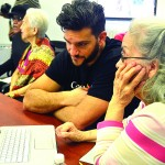 Google volunteer Aivel Eidels works with seniors.