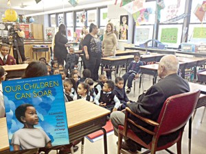 Dinkins read to preschoolers from <i>Our Children Can Soar</i>.