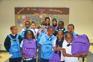 Students receive backpack donations.