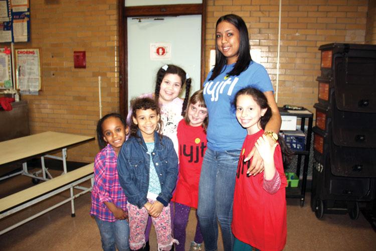 NYJTL's Krystal Tiburcio with students.