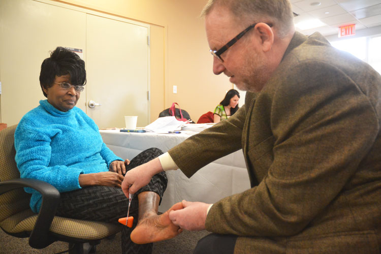 Bronx resident Betty Dennis had her feet examined.