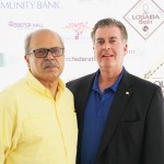 Raul Russi (left), Acacia Network CEO, and Brian Doran, Popular Community Bank Vice President of Governmental Affairs.