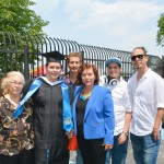 The graduate is surrounded by, from left to right, her grandmother Toribia, her father Peter, her mother Mercedes, her son Miguel, and her brother Leandro.