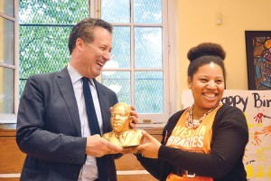 Library Manager Junelle Carter-Bowman (right) presents a bust of Martin Luther King Jr. to NYPL's Tony Marx.