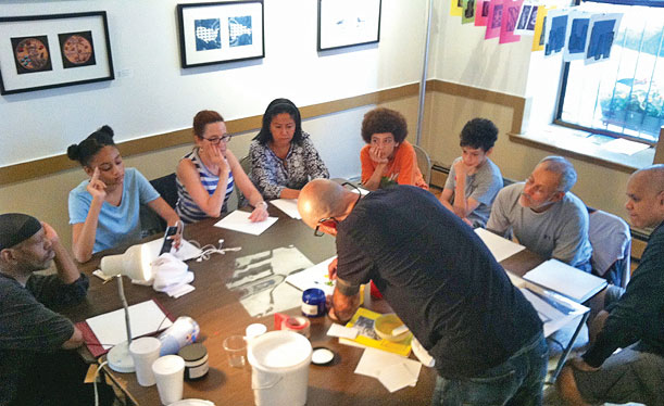The artists offer printmaking demonstrations.