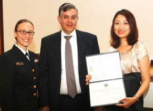 From left to right: Liatte Krueger, PharmD, U.S. Public Health Service, presents award to Kim; Touro College of Pharmacy Interim Dean Dr. Zvi Loewy; and Colleen Kim.