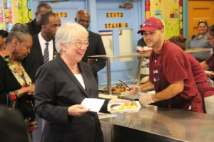 Schools Chancellor Carmen Fariña lines up for lunch.