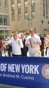Assemblymember Guillermo Linares (left) marches with Cuomo.