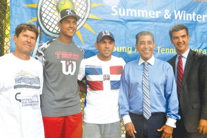 Professional tennis player Víctor Estrella Burgos (center) visited with local youths.