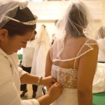 Women dressed in white prepared for the 12th Annual Brides March against domestic violence.