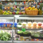 The deli counter offers fresh fruit.