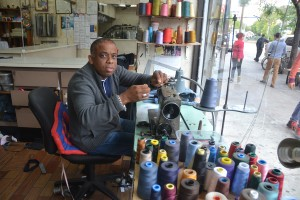 Tailor Alberto Miliano works on his alterations.