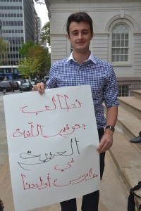 "The sign reads ""We demand the provision of Arabic language in the schools for our children."""
