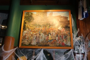 This painting features staff members and longtime patrons in medieval garb.