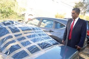 Espaillat inspects a damaged car.