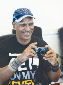 """Homeless people view things differently,"" says photographer German Rosa, here receiving his camera. Photo: Stephanie Warren"