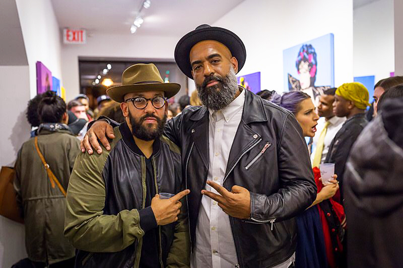 Proprietor Jose Morales (left) with friend and artist M. Tony Peralta.