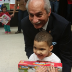Assemblymember Guillermo Linares lends a hand.