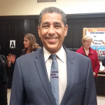 State Senator Adriano Espaillat recalled holiday memories of his own.