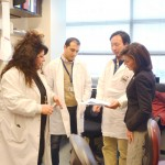 New York's Lieutenant Governor Kathy Hochul chats with CUMC Dr. Angela Christiano (left) and other researchers.