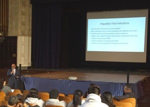 Physician Dr. Mitchell F. Harrison addresses high school seniors at a recent health forum.